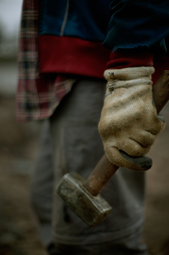 Close up of hand holding a construction hammer