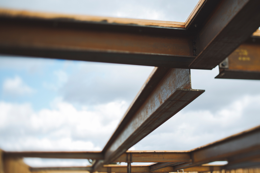Steel beams and sky at construction site